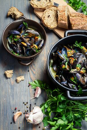 Fresh garlic and parsley to prepare mussels photo