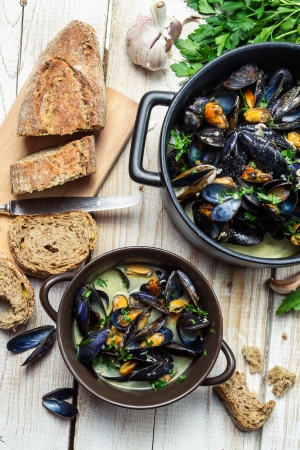 Mussels served with bread by the sea Stock Photo