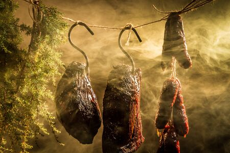Hanging ham in the smokehouse photo