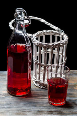 Old bottles with red juice photo