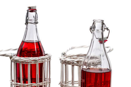 Closeup of red juice in bottles photo