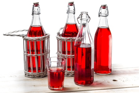 Vintage bottles with red juice photo