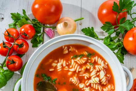 Fresh tomato soup made of vegetables photo