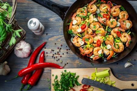 mediterranean food: Freshly fried shrimps with herbs