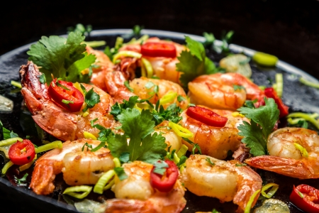 food staple: Closeup of shrimps on pan with herbs Stock Photo