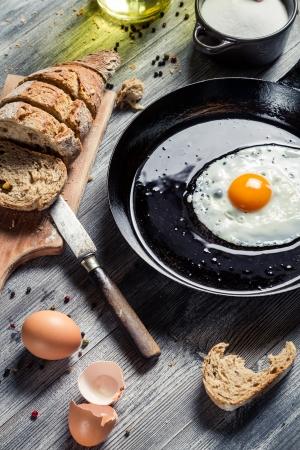 Freshly fried egg on a pan Stock Photo - 18268785