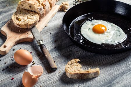 Fried egg on a pan and served with bread Stock Photo - 18268750