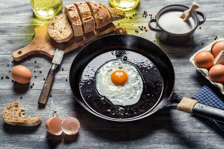 Fried egg on a pan and served with bread Stock Photo - 18268794