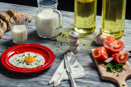 Fried eggs and bread for breakfast with vegetables Stock Photo - 18268738