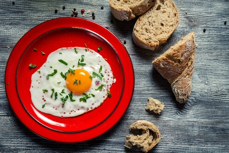 Closeup of egg served with parsley and bread Stock Photo - 18268787