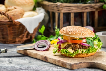 Closeup of burger made from beaf and fresh vegetables Stock Photo