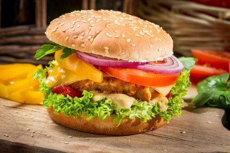 gourmet burger: Closeup of a hamburger with chicken and vegetables Stock Photo