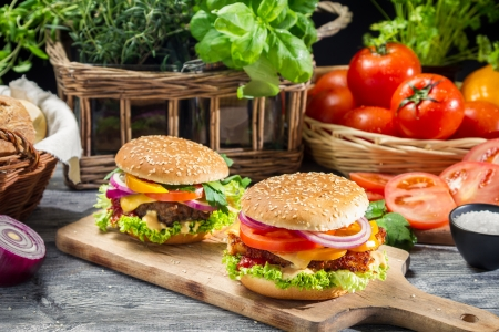 cheeseburgers: Two homemade burgers made from fresh vegetables Stock Photo
