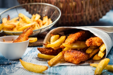 fish oil: Closeup of Fish & Chips served in paper