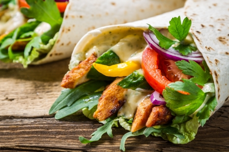 burrito: Closeup of kebab in a pancake with vegetables Stock Photo