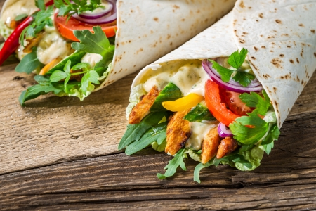 Closeup of tasty kebab with vegetables and chicken photo