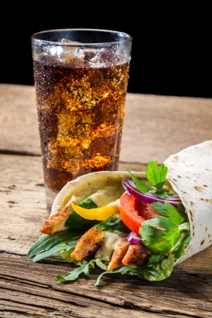 Closeup of kebab with fresh vegetables on black background photo