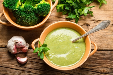 pureed: Creamy soup made of fresh broccoli and parsley Stock Photo