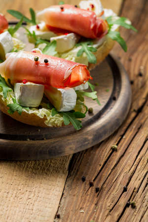 Fresh sandwiches on a old wooden cutting board background 2 photo