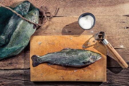 fish rearing: Preparing freshly caught fish from the lake