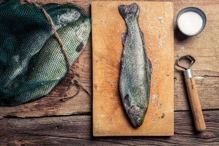 fish rearing: Preparing freshly caught dinner