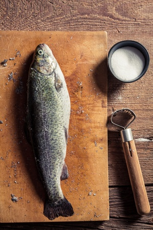 fish rearing: Peeling the shells of fresh fish