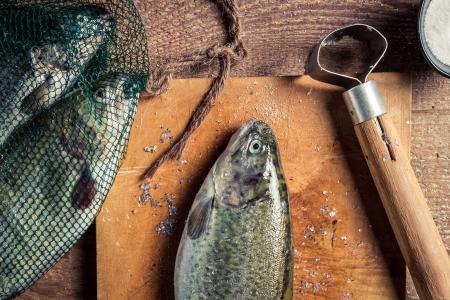 fish rearing: Closeup of preparing freshly caught dinner