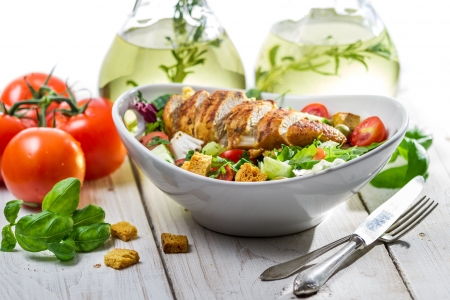 Fresh salad made of chicken, tomato, olive and fresh herbs Stock Photo - 19111087