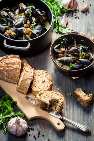 rustic food: Bread and mussels  with garlic and parsley