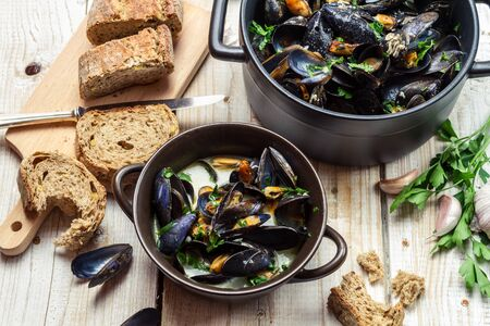 Mussels served with homemade bread by the sea photo