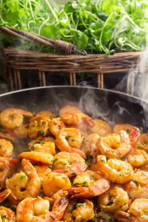 Hot shrimp fried in a pan with fresh herbs Stock Photo - 19111125