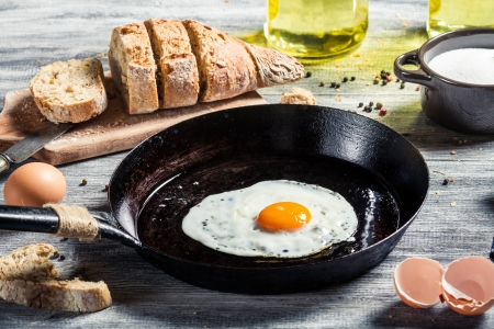 sunny side up: Homemade bread and fresh fried egg Stock Photo