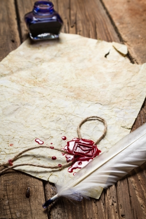beeswaxseals: Closeup of a feather lying on vintage letter with red sealing wax Stock Photo
