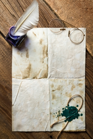 Blue ink, feather on old vintage letter with green sealing wax Stock Photo - 19439793
