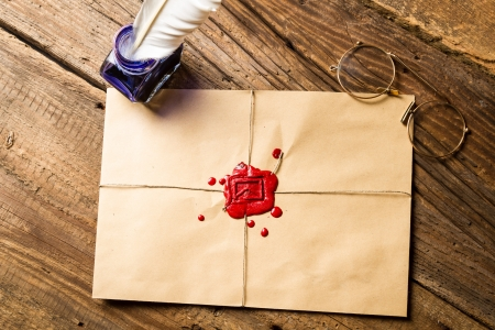 beeswaxseals: Envelope with imprinted sealing wax and inkwell with blue ink