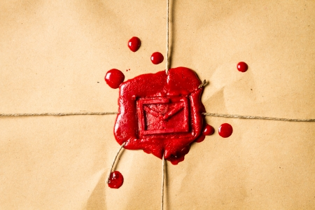 Close-up on an envelope with red sealing wax photo