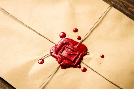 Close-up on an envelope with red sealing wax and old thin rope Stock Photo - 19439479