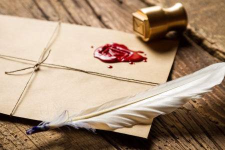 beeswaxseals: Closeup of feather on envelope with red sealant and metal stamp