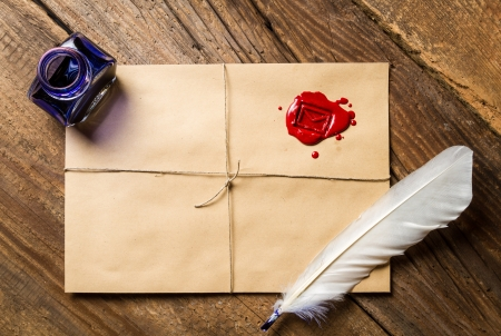 beeswaxseals: Feather on envelope with red sealant and inkwell Stock Photo