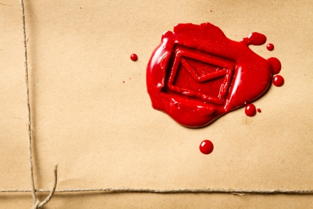 Close-up on the envelope symbol imprinted in red sealing wax photo