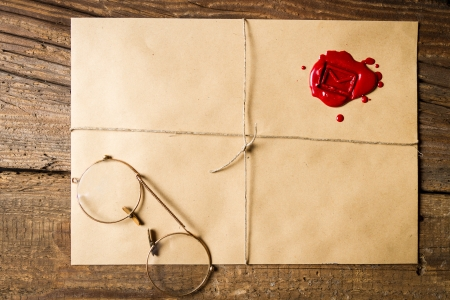 Envelope with imprinted sealing wax and old glasses Stock Photo - 19439844