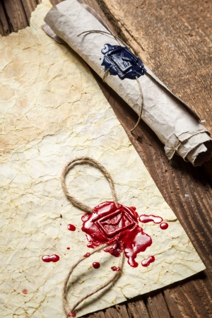 Close-up of the scroll and old paper with red sealant photo