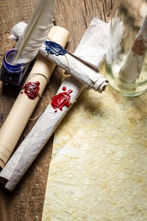 Preparing to sending ancient letter in a bottle photo
