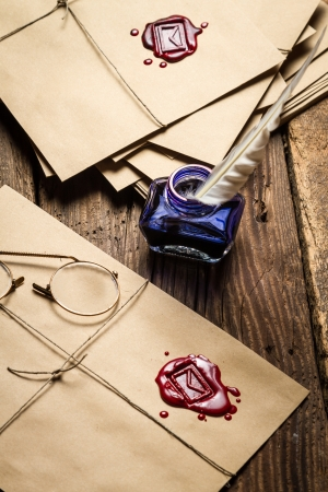 Viewing vintage mail with red sealant and glasses Stock Photo - 19439616