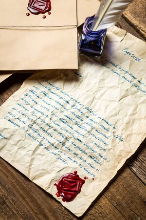 Old letter sealed with red sealant and written in blue ink photo