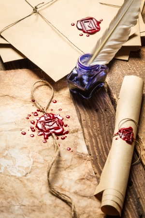 beeswaxseals: Old scrolls, sealing wax and blu ink on wooden table Stock Photo