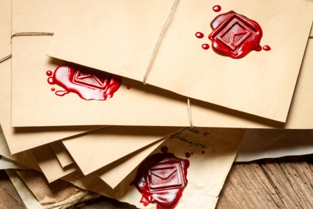 sealant: Stack of vintage envelopes with red sealant Stock Photo