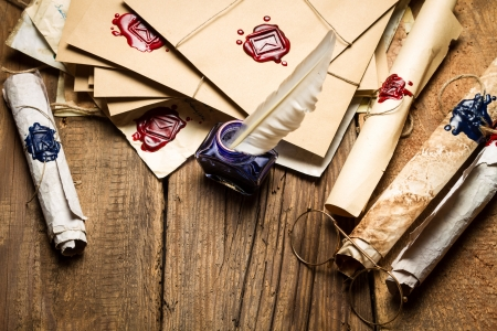 Ancient scrolls and old envelope with blue inkwell Stock Photo