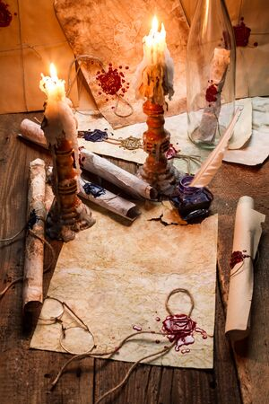 Old scrolls and candles are the old scribe's workplace photo