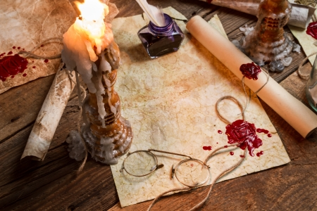 beeswaxseals: Closeup of table filled with old messages and candles
